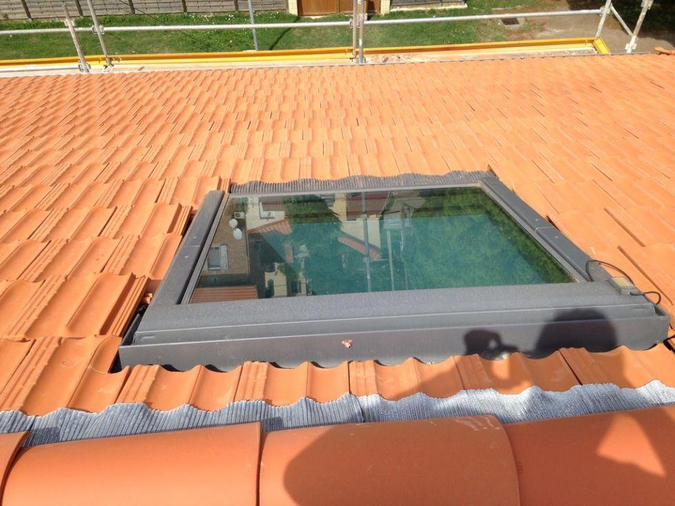 Pose de fen tres de toit velux pose et r paration for Pose fenetre de toit velux